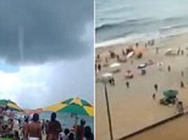 TORNADO hits Brazilian beach sending sunbathers running for their lives